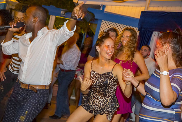 People Enjoying Dance and Music at the Wharf Restaurant