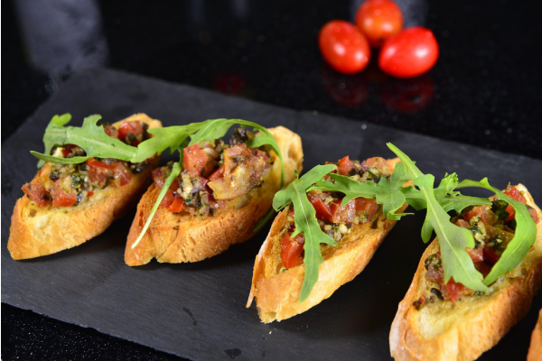 Indulge in the Exotic Fusion of Spanish Cuisine and Caribbean Flavors